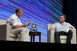 Kane Calamari asks retailer-submitted questions during the live Q&A with keynote speaker, General Stanley McChrystal.